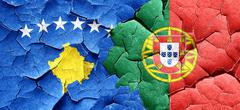 Kosovo flag with Portugal flag on a grunge cracked wall Stock Illustration