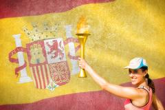 Happy woman raising a cup  against digitally generated spanish national flag - stock photo