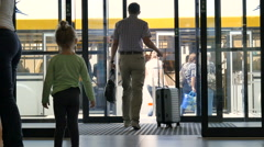 The family comes in to land at the airport Stock Footage