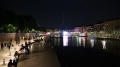 Milan new Darsena, redeveloped docks area with people at night Stock Footage
