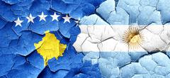 Kosovo flag with Argentine flag on a grunge cracked wall - stock illustration