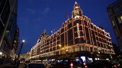 The famous Harrods department store illuminated in London at night Stock Footage