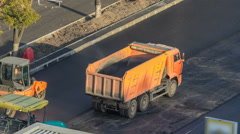 Workers operating asphalt paver machines during road construction and repairing Stock Footage