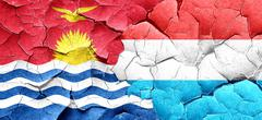 Kiribati flag with Luxembourg flag on a grunge cracked wall - stock illustration