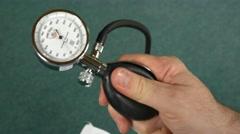 Doctor using medical tools blood pressure stethoscope model arteries spine bone Stock Footage