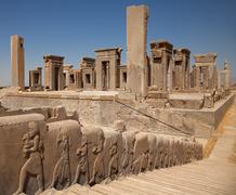 Embossed bas relief carvings of servants bringing gifts in Persepolis Stock Photos