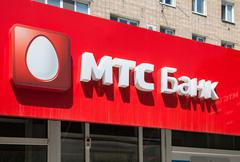 A sign with the logo office of the Russian MTS Bank. Text in russian: MTS Ban - stock photo