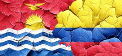 Kiribati flag with Colombia flag on a grunge cracked wall - stock illustration