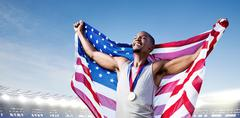 Composite image of portrait of american sportsman is smiling for victory - stock photo