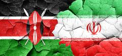 Kenya flag with Iran flag on a grunge cracked wall - stock illustration
