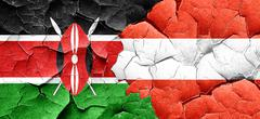 Kenya flag with Austria flag on a grunge cracked wall Stock Illustration