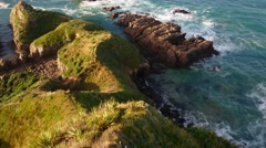 Waves Crashing Onto Rocks, Nugget Point Lighthouse, Pan Up Stock Footage
