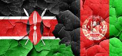 Kenya flag with afghanistan flag on a grunge cracked wall Stock Illustration