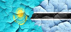 Kazakhstan flag with Botswana flag on a grunge cracked wall Stock Illustration