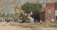 Helper Utah tearing out road and sidewalk business downtown fast DCI 4K Stock Footage