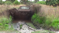 Mud truck driving through the mud  - stock footage