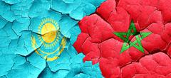Kazakhstan flag with Morocco flag on a grunge cracked wall Stock Illustration