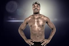 Composite image of swimmer smiling and posing with hands on hips against ligh Stock Photos