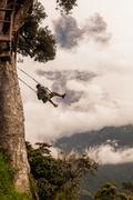 Adult Caucasian Man Swinging On A Swing In Banos De Agua Santa Stock Photos