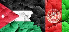 Jordan flag with afghanistan flag on a grunge cracked wall Stock Illustration