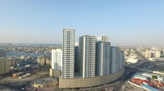 Pearl towers. Cityscape of Ajman with modern buildings aerial view Stock Footage