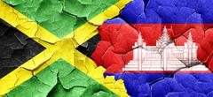 Jamaica flag with Cambodia flag on a grunge cracked wall Stock Illustration