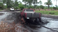 Mud truck driving through the mud pan - stock footage