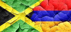 Jamaica flag with Armenia flag on a grunge cracked wall Stock Illustration