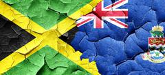 Jamaica flag with Cayman islands flag on a grunge cracked wall Stock Illustration