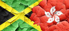 Jamaica flag with Hong Kong flag on a grunge cracked wall Stock Illustration