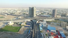 Fly over the road near Pearl towers. Cityscape of Ajman aerial Stock Footage