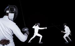 Man wearing fencing suit practicing with sword against black background Kuvituskuvat