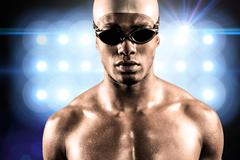 Composite image of swimmer ready to dive against spot light - stock photo