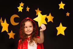 Little dreamer holding shooting star - stock photo