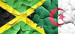Jamaica flag with Algeria flag on a grunge cracked wall Stock Illustration