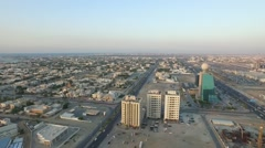 Turn around near Pearl towers. Cityscape of Ajman with modern buildings aerial Stock Footage