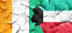Ivory coast flag with Kuwait flag on a grunge cracked wall Stock Illustration