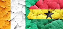 Ivory coast flag with Ghana flag on a grunge cracked wall Piirros