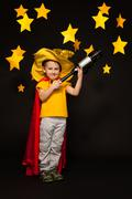 Kid boy playing sky watcher with a telescope Stock Photos