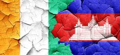 Ivory coast flag with Cambodia flag on a grunge cracked wall Stock Illustration
