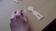 Home crafts (doll magnet for fridge) 12 - stock footage