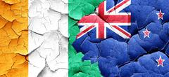 Ivory coast flag with New Zealand flag on a grunge cracked wall Stock Illustration