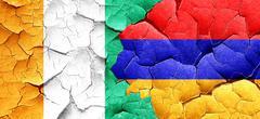 Ivory coast flag with Armenia flag on a grunge cracked wall - stock illustration
