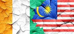Ivory coast flag with Malaysia flag on a grunge cracked wall - stock illustration