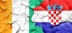 Ivory coast flag with Croatia flag on a grunge cracked wall Stock Illustration