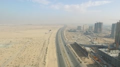 Emirates city towers over highway. Cityscape of Ajman aerial Stock Footage