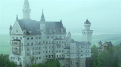 Castle Neuschwanstein in Germany with moving fog Stock Footage