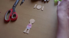 Home crafts (doll magnet for fridge) 21 - stock footage