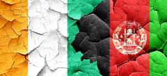 Ivory coast flag with afghanistan flag on a grunge cracked wall - stock illustration