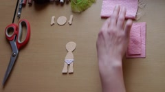 Home crafts (doll magnet for fridge) 14 - stock footage